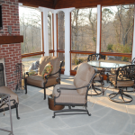 Photo of Screened Porch Sitting and Dining Area